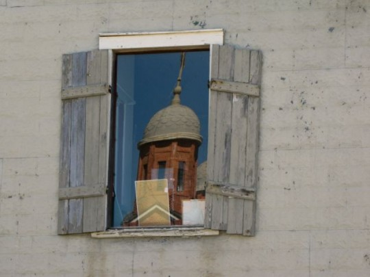 Church Reflection In Window
