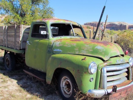 Old Green Truck In Bluff